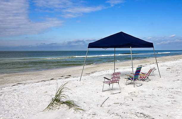 Portable Beach Shelter and Chairs stock photo