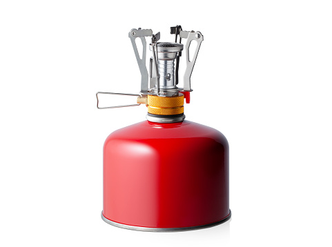 Portable camping stove with butane/propane gas canister isolated on white background.