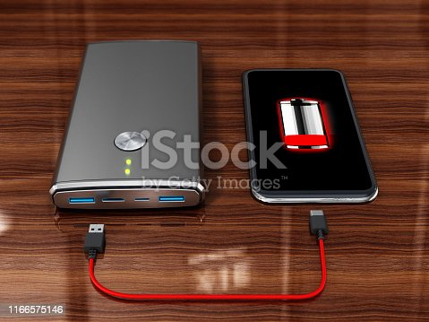 Portable charger or powerbank charging smartphone with low battery.