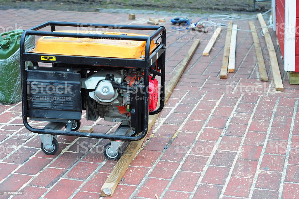 Portable Generator with wheels on the House Construction Site. stock photo