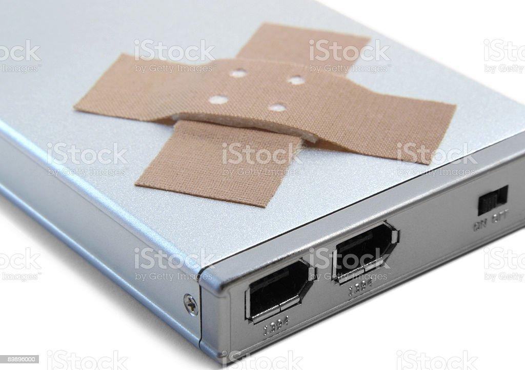 Disco duro portátil y adhesivo plastrer foto de stock libre de derechos