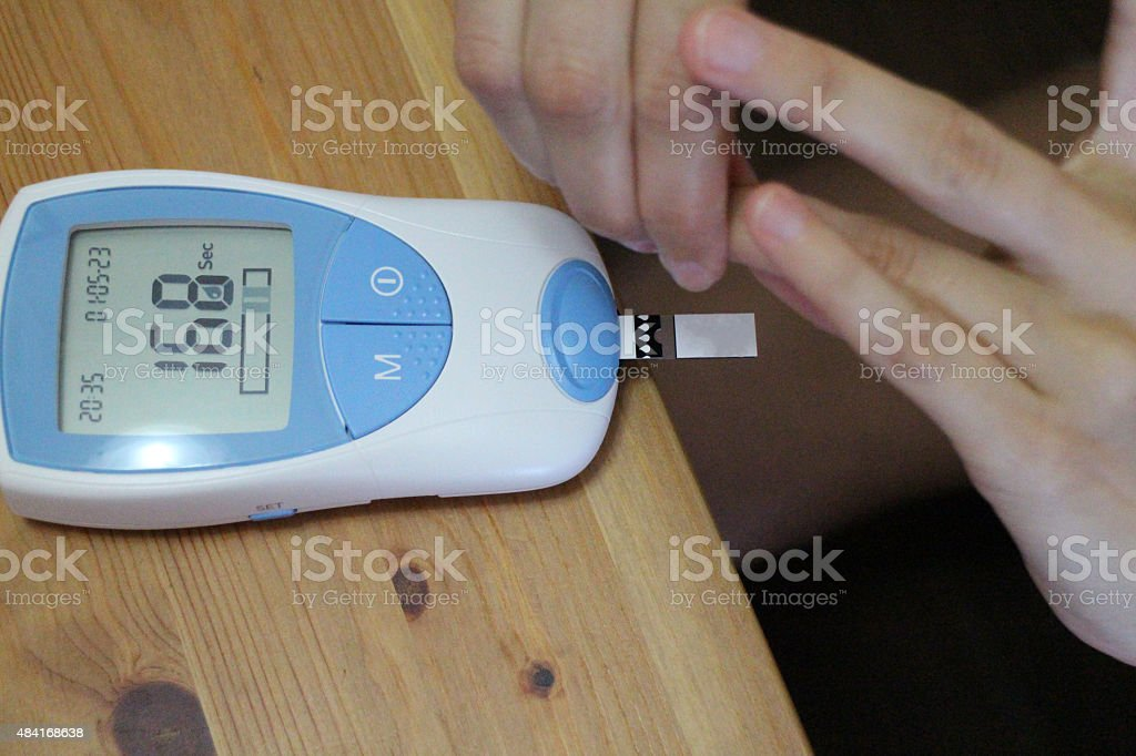Portable INR Blood Clotting Test at Home stock photo
