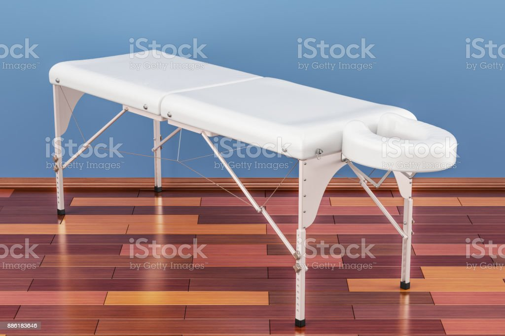 Portable Massage Table In Room On The Wooden Floor, 3D Rendering Stock Photo