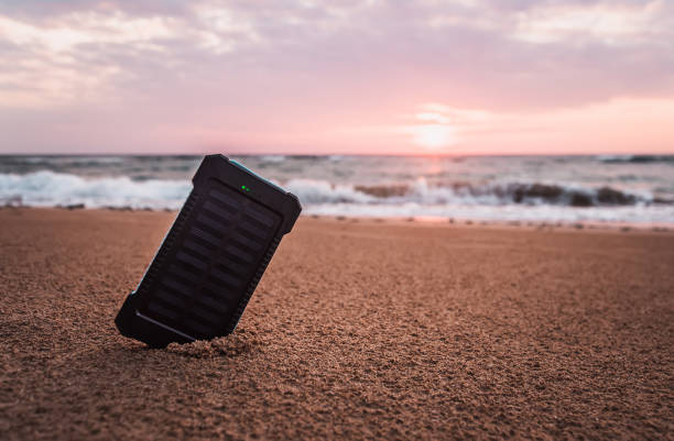 Portable solar panel is on the beach in the sand stock photo