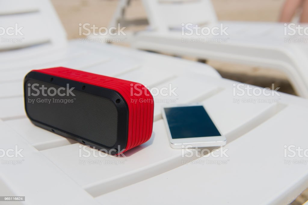 Portable speaker and smartphone outdoors royalty-free stock photo