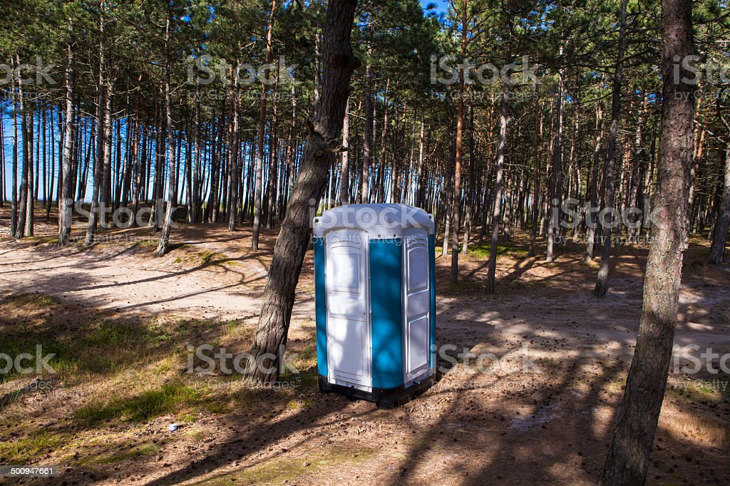 Portable Toilet in forest stock photo