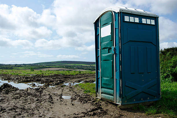 Portable Toilet In Muddy Field With View  portable toilet stock pictures, royalty-free photos & images