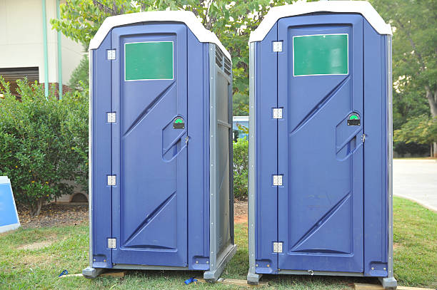 Portable Toilets Two portable toilets for festival. portable toilet stock pictures, royalty-free photos & images