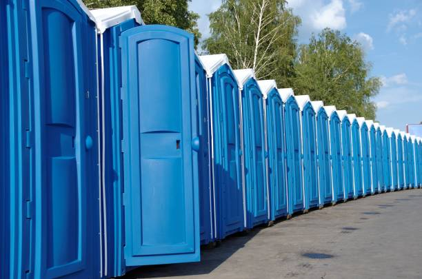 Portable toilets A line of portable toilets. portable toilet stock pictures, royalty-free photos & images