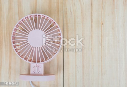istock portable USB fan on wooden frame for cool temperature 1147462812