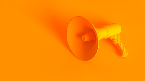 istock Portable wireless megaphone. Conceptual stereoscopic image full toned in orange color. 1176088836