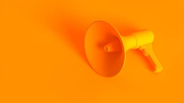 portable wireless megaphone. conceptual stereoscopic image full toned in orange color. - megafono foto e immagini stock