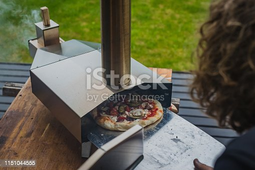 874991150istockphoto Portable wood fired pizza oven 1151044555