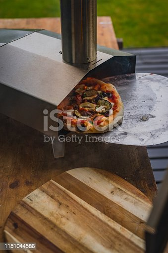 874991150istockphoto Portable wood fired pizza oven 1151044586