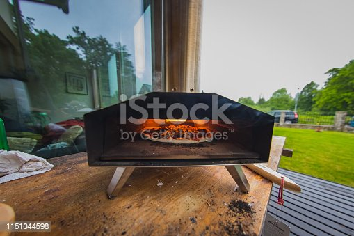 874991150istockphoto Portable wood fired pizza oven 1151044598