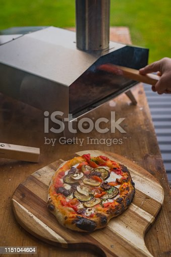 874991150istockphoto Portable wood fired pizza oven 1151044604