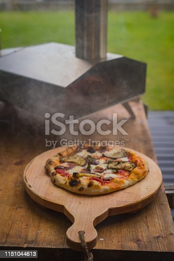 874991150istockphoto Portable wood fired pizza oven 1151044613