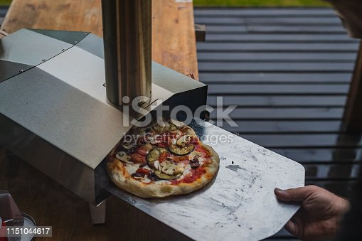 874991150istockphoto Portable wood fired pizza oven 1151044617