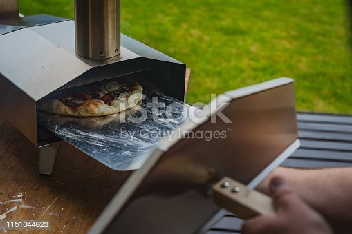 874991150istockphoto Portable wood fired pizza oven 1151044623