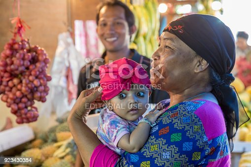 istock Portait of a colorful Indonesian baby 923430384