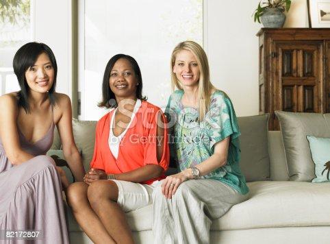 istock Portait of three women sitting on sofa 82172807