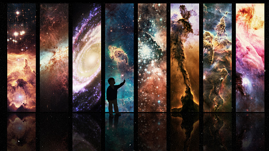 Silhouette of a child looking at a display of varying galactic phenomena- ALL design on this image is created from scratch by Yuri Arcurs'  team of professionals for this particular photo shoothttp://195.154.178.81/DATA/i_collage/pi/shoots/783653.jpg