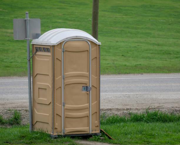 Portapotty on Roadside stock photo