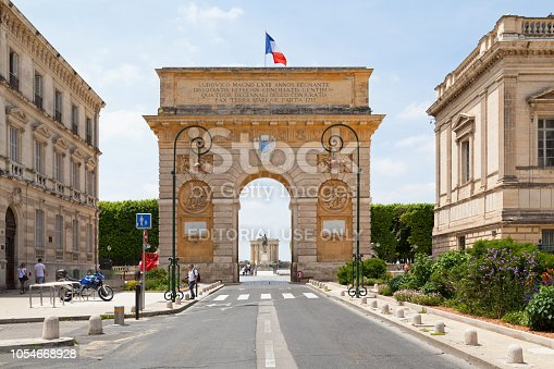 Montpellier, France - June 09 2018: The Porte du Peyrou is a triumphal arch situated at the eastern end of the Jardin de Peyrou, a park near the center of the city.