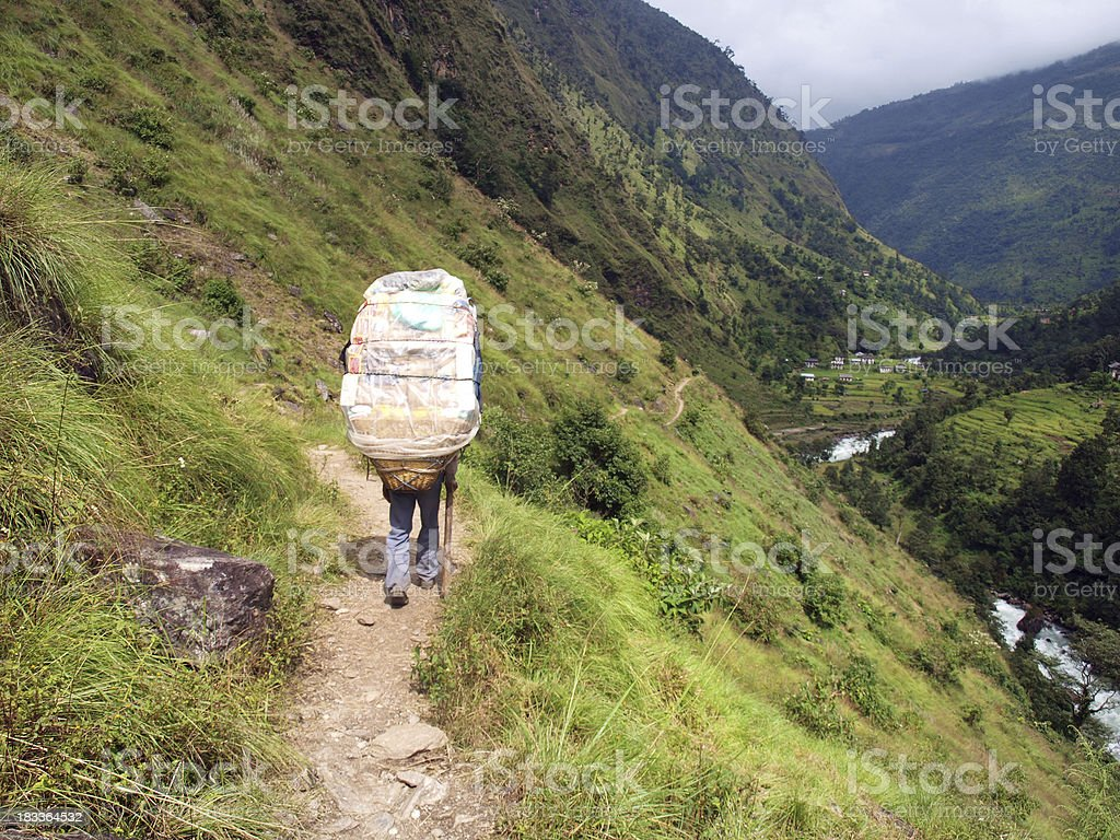 Porter carrying supplies in Himalaya royalty-free stock photo