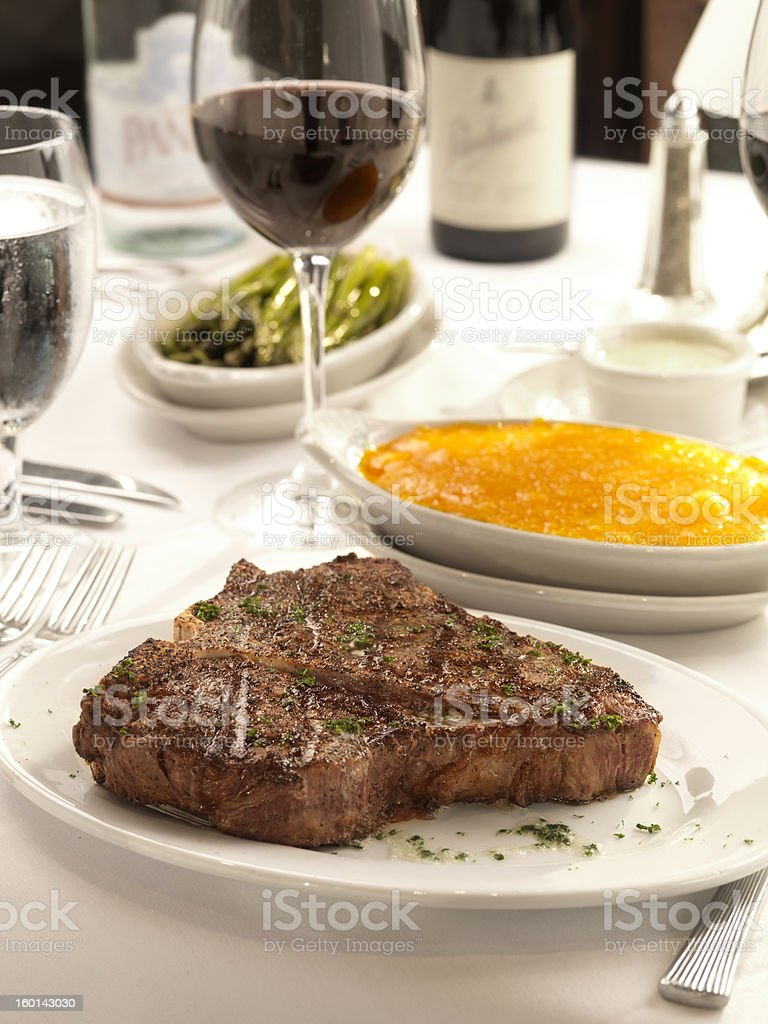 Porterhouse steak and cheese grits royalty-free stock photo