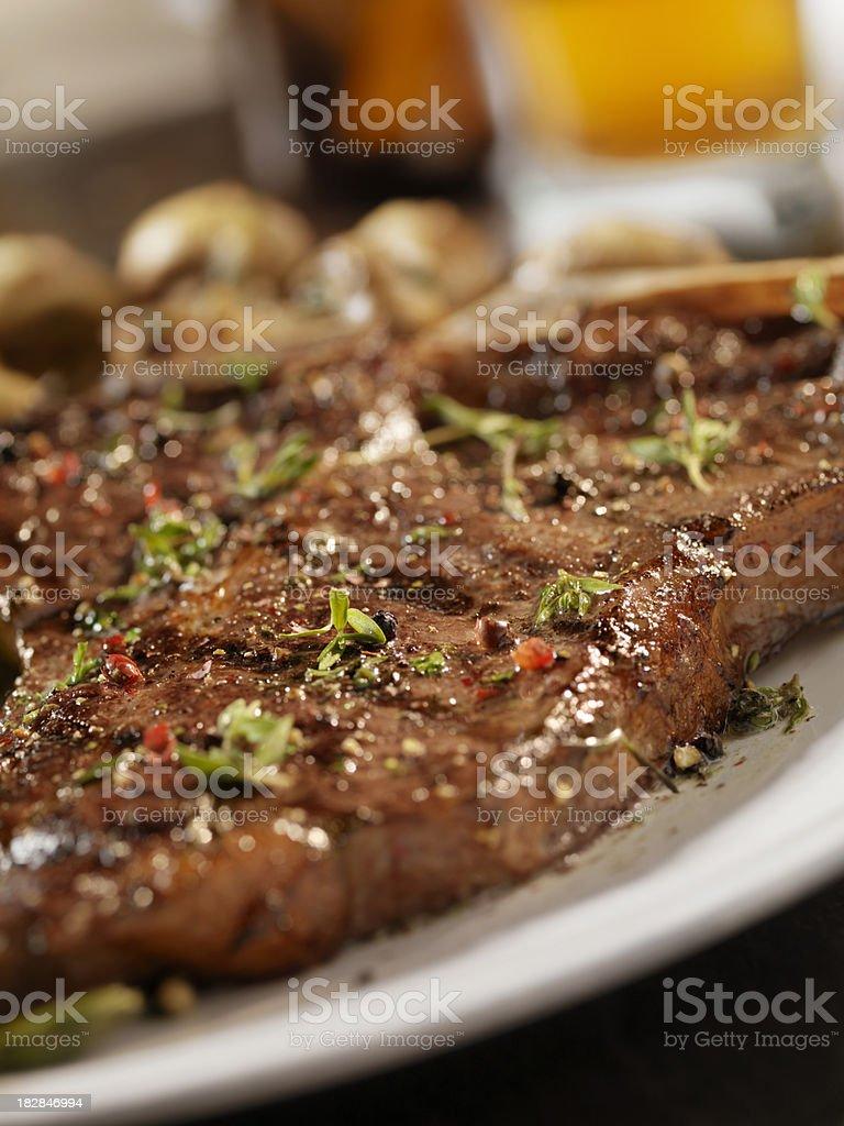 Porterhouse Steak with Sauteed Mushrooms royalty-free stock photo