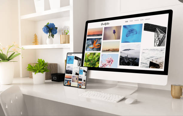 portfolio website on home office setup stock photo