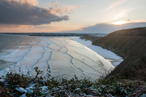 Porth Kidney Sands with snow near St Ives in Cornwall