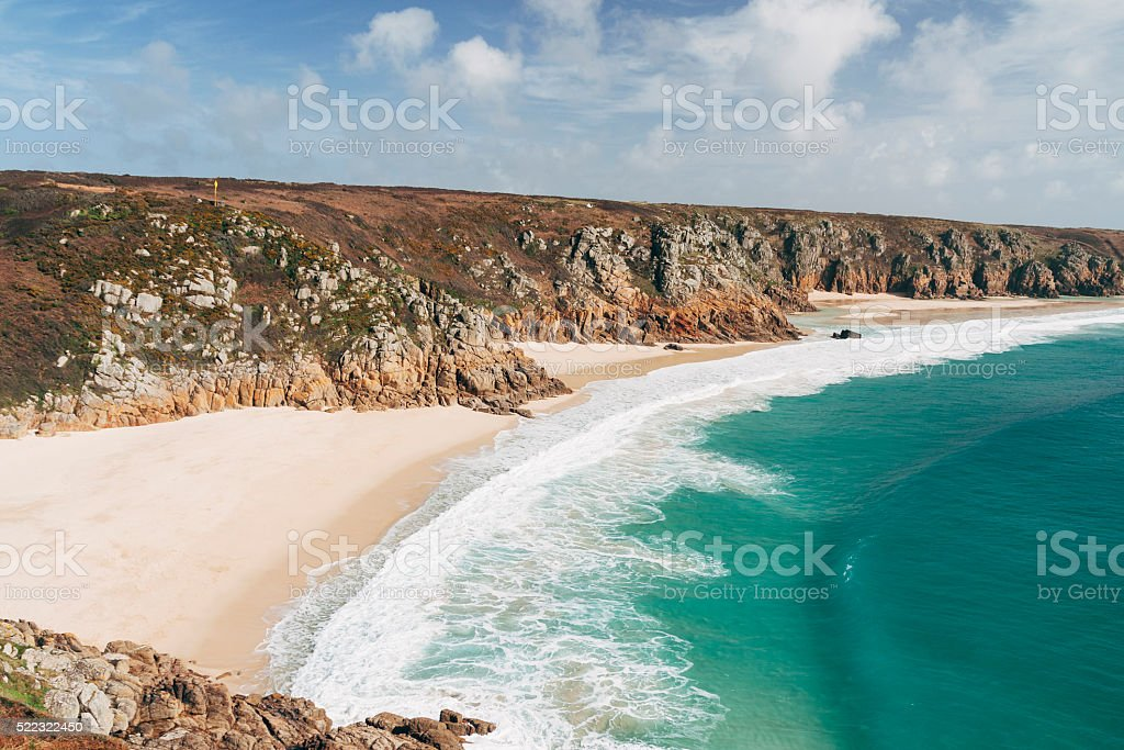 Porthcurno beach and cliffs in West Cornwall, England stock photo