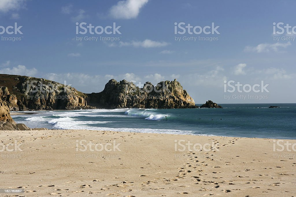 Porthcurno beach with atlantic waves and cliffs in West Cornwall stock photo