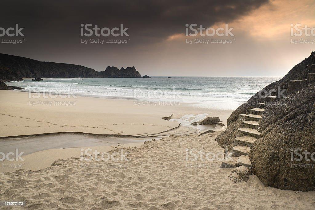 Porthcurno yellow sand beach before sunset royalty-free stock photo
