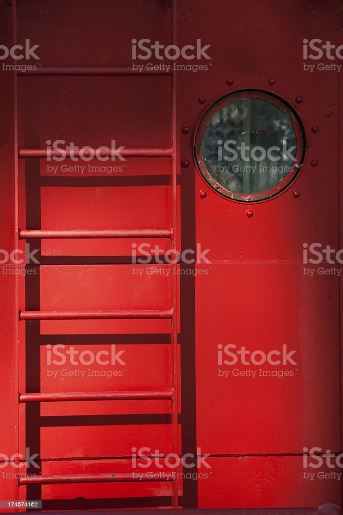 Porthole and ladder on a red ship royalty-free stock photo