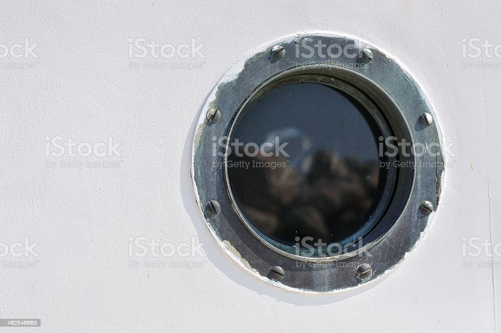 Porthole in the white hull of passenger ship stock photo