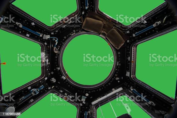 Photo of Porthole of space station isolated on green background. Elements of this image furnished by NASA.