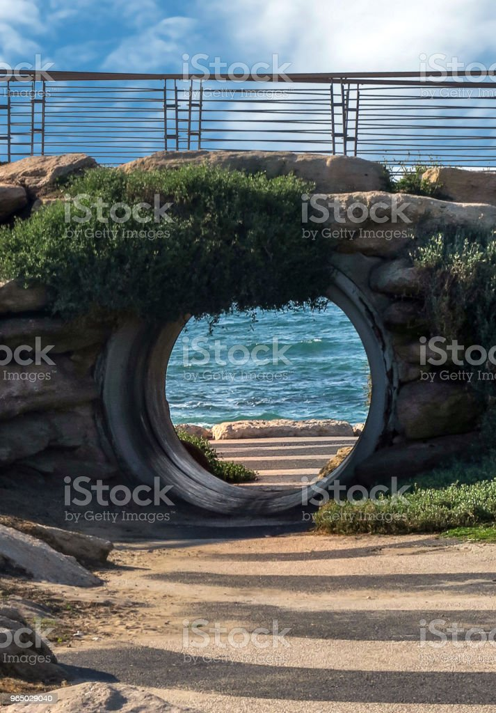 porthole shaped entrance onto the mediterranean sea beach in downtown tel aviv, israel royalty-free stock photo