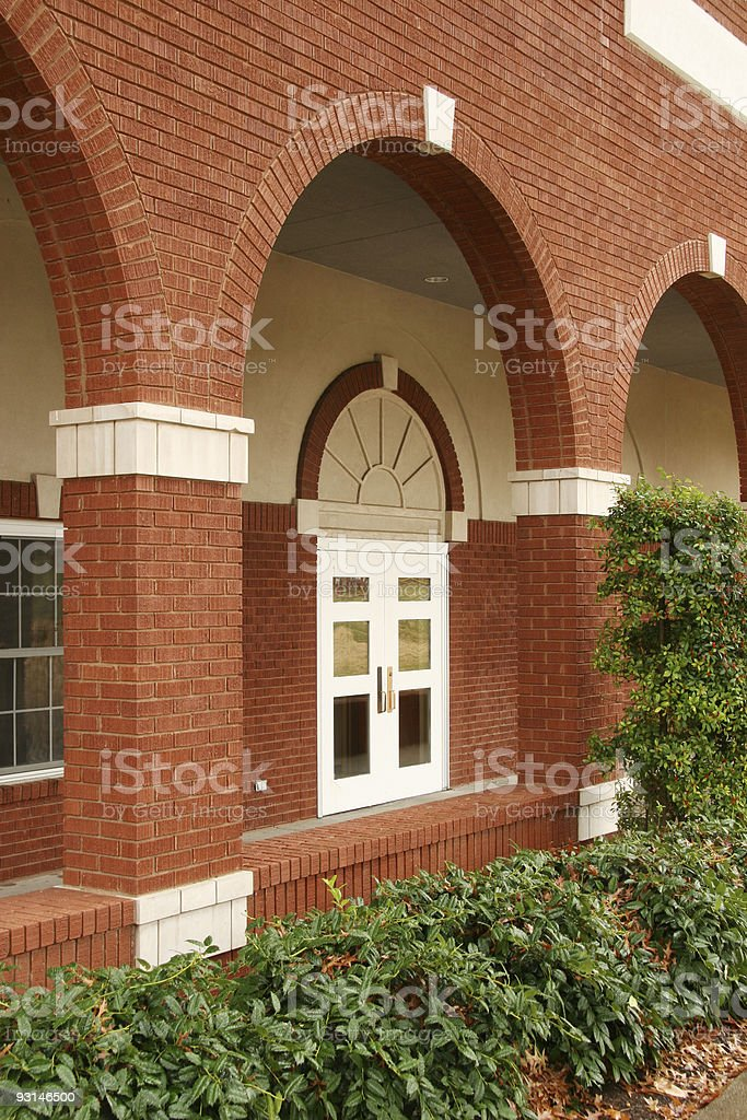 Portico and Red Brick, White Door royalty-free stock photo