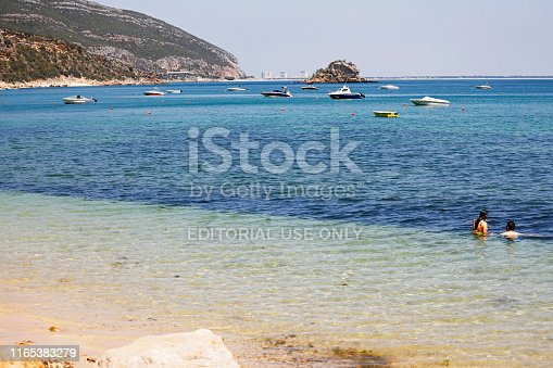 Portinho da Arrábida, Setubal, Portugal - June 29, 2019: Tourists enjoy in Praia do Portinho da Arrábida, a beautiful beach located in the Natural Park of Arrabida, in Setubal District, in Portugal.