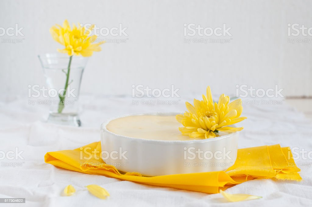 Portion cheesecake on white and yellow background stock photo