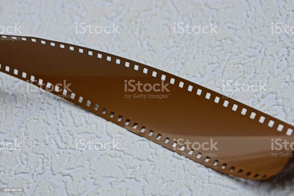 A portion of a brown film on a gray surface stock photo