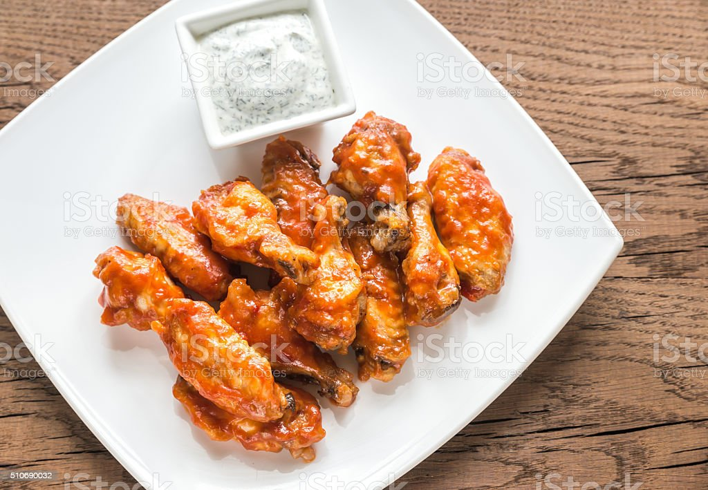 Portion of buffalo chicken wings stock photo