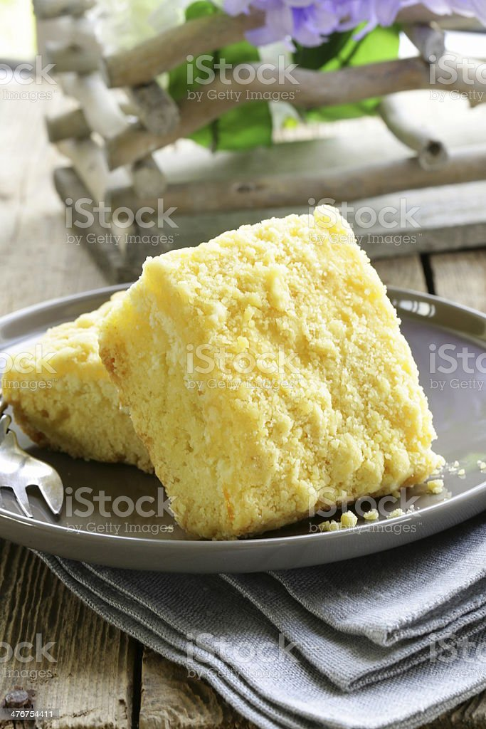 portion of cheesecake with orange flavor on the plate royalty-free stock photo