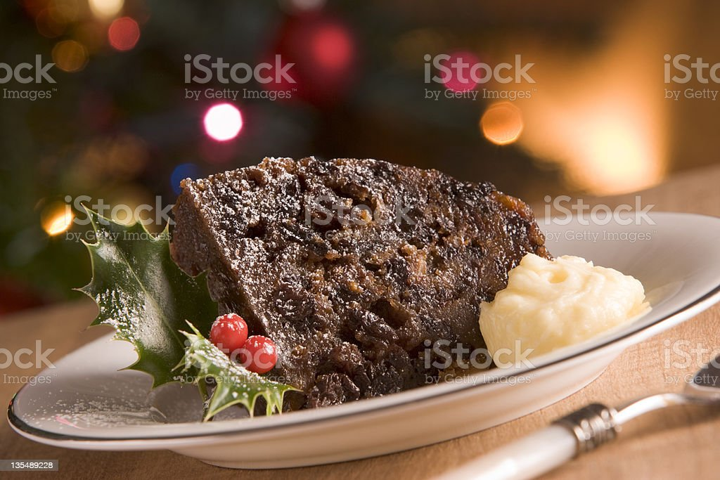 Portion of Christmas Pudding with Brandy Butter stock photo