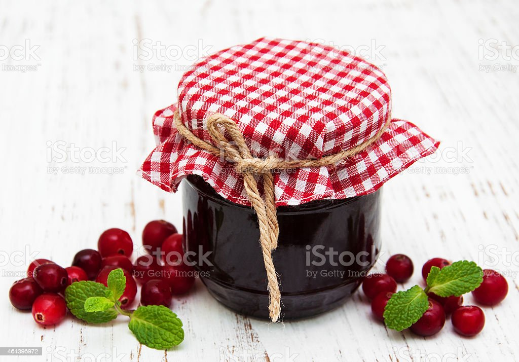 portion of cranberry jam with fresh fruits stock photo