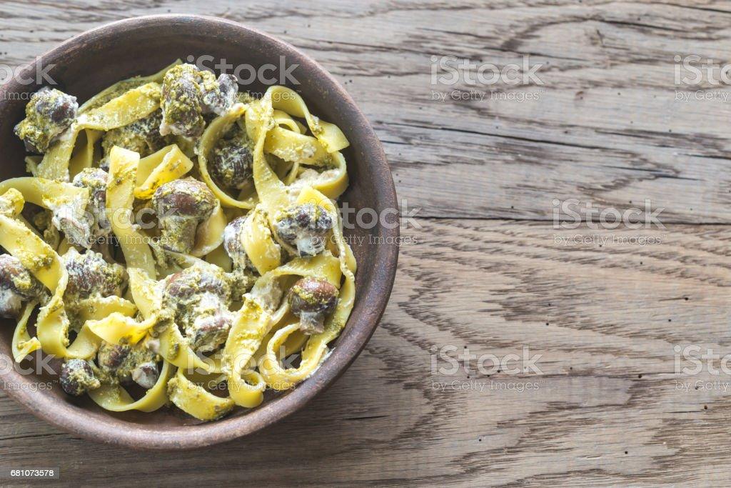 Portion of creamy mushroom pasta with pesto royalty-free stock photo