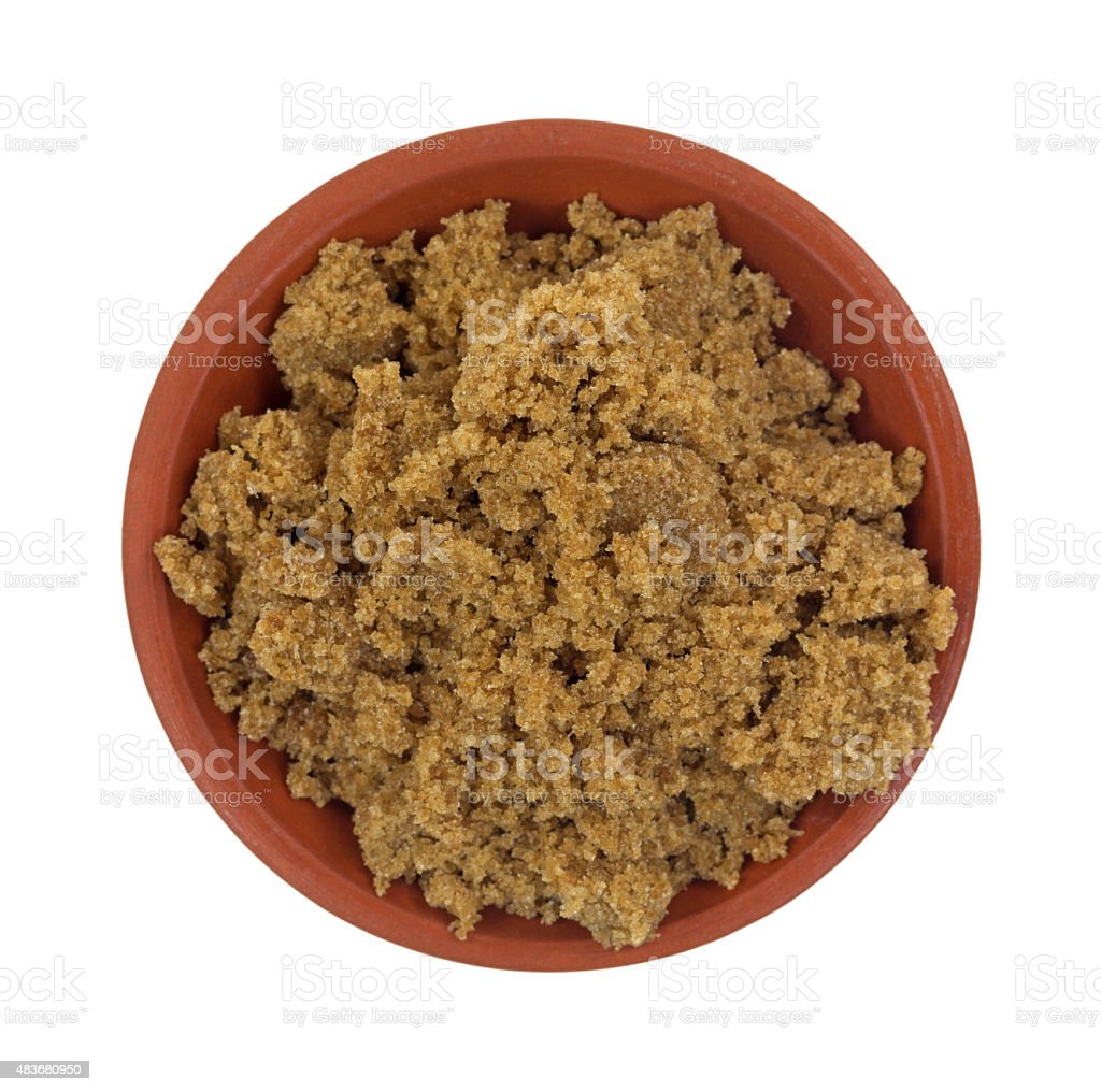 Portion of dark brown sugar in bowl stock photo